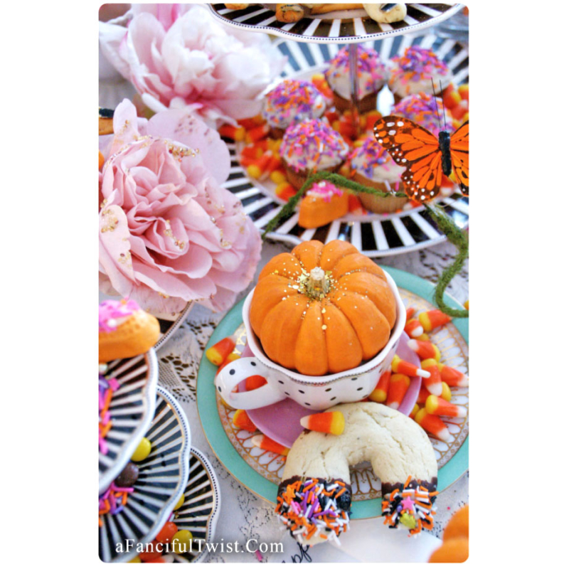 Pumpkin in a teacup halloween party front