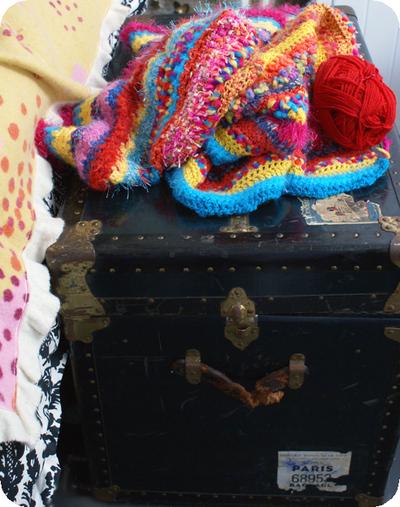 Giant_crocheted_blanket_on_trunk