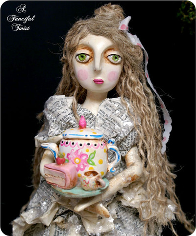Tea_and_cake_girl_upclose